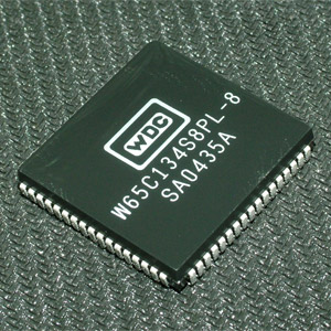 This is a Picture of the W65C134S8PL-8 8-bit Microcontroller Plastic Leaded Chip Carrier,  											68 pin package. The W65C134S is a feature rich 8-bit microcontroller based on the W65C02 with  											an advanced Serial Interface Bus token passing and many other features.